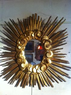 Mirror #LouisXIV, middle of the 17th century, in #limewood, carved and #gilt with a radiant sun in the clouds. This piece is close to the drawings of the architect from Avignon, Francis Royers De La Valfrenière, dated 1659 the altarpiece of the church of St. Peter in Avignon. For sale on #Proantic by Serignan Antiquités.