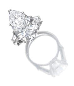 Attractive diamond ring, Harry Winston Set with a pear-shaped diamond weighing 8.90 carats, between tapered baguette diamond shoulders, mounted in platinum, size 47, with additional sizing band, maker's marks for Jacques Timey, signed Winston.