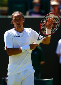 Alexandr Dolgopolov Photos - Day Two: The Championships - Wimbledon 2015 - Zimbio