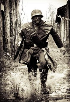German soldier splashing in puddles in the 1940s