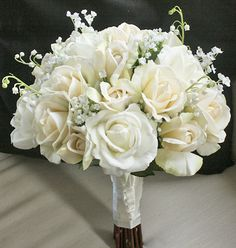 This is a perfect bouquet with Off White and Cream/Champagne Roses accented Garden Fresh fillers like Lilies of the Valley and Babys Breath. These are
