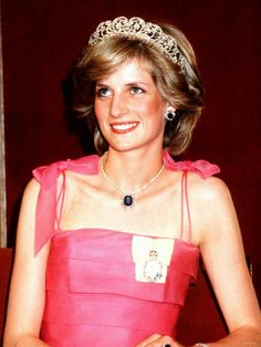 Diana wearing the Spencer tiara, along with diamond and sapphire jewelry from the Saudi Royal Family as a wedding gift, at a gala in Australia. The miniature of the Queen was a gift from Her Majesty.