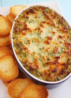 Hot Cheesy Spinach-Artichoke Dip http://www.thecomfortofcooking.com/2013/12/hot-cheesy-spinach-artichoke-dip.html