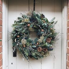 Give your home a touch of elegance with this stunning fresh winter foliage wreath from Bramble & Wild. The natural design is created and built upon a mossed frame to ensure longevity through the winter months. This welcoming wreath is beautifully handmade, filled with an array of seasonal foliage, twigs, pinecones and orange slices to add texture and style to any front door.