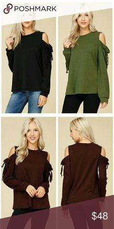 "Cold Shoulder Sweater Top Here is the ultimate new addition to your fall wardrobe! Luxurious feeling cross between a sweater and sweatshirt. Sexy cutout shoulders with unique ruching and bow details. Fits true to size. BLACK is available at this time, but all photos will give you a good idea of how it fits. Get yours before they're gone!  95% polyester, 5% spandex.  Small = Bust 38"", Length 24.5"" Medium = Bust 40"", Length 25.5"" Large = Bust 42"", Length 26"" Crescent Tops"