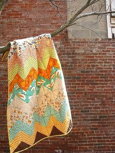 I have the fabric, and now need a pattern. This chevron quilt is sweet and easy!