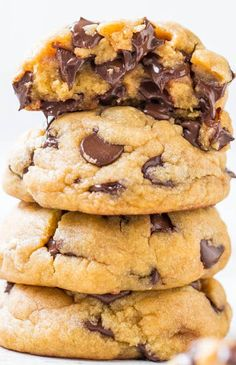 Not healthy.The Best Soft & Chewy Coconut Oil Chocolate Chip Cookies - You'll never miss the butter in these cookies that are so soft & loaded to the max with chocolate! A hit at any party! Just Desserts, Delicious Desserts, Yummy Food, Coconut Oil Chocolate, Melted Chocolate, Cookie Recipes, Dessert Recipes, Baking Recipes, Soft Chocolate Chip Cookies