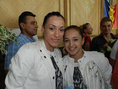 Romania's Cătălina Ponor and Larisa Iordache after the Games
