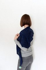 Unilintu is a triangular top-down shawl/scarf. The shape of the shawl is a horizontally wide and vertically shallow triangle. Alternating garter stitch and eyelet rows create a simple stripey texture.
