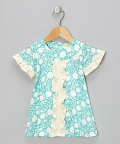 With a darling print and ruffles in all the right places, this charming dress is set to impress. Soft organic cotton and easy-changing snaps in back prove that a little one doesn't have to sacrifice comfort for style. 100% organic cottonMachine washImported