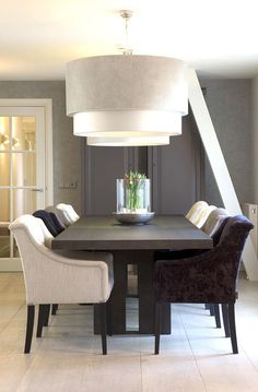 Dining Room Design Ideas - Dark wood dining room table with monochrome chairs, and decorative overhead light fixture (chandelier) Keijser & Co