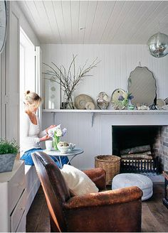 love the old trays and mirrors on the mantel.