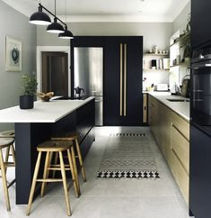 A striking combination of black painted cabinetry with exposed oak fronts, the Cranbrook kitchen creates an eye-catching Scandi kitchen design. Home Living, Kitchen Living, New Kitchen, Family Kitchen, Narrow Kitchen Island, Open Plan Kitchen, Narrow Kitchen Extension, Black Kitchens, Home Kitchens