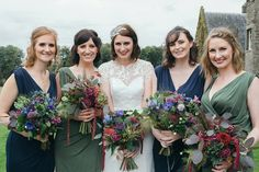 Bridesmaids wear mismatching green and blue dresses. Photography by http://www.mirrorboxphotography.com/