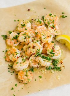 My favorite recipes are the ones I call fancy-not-fancy. A little luxurious, but so quick and easy they might actually qualify as 15-minute meals. Roasted shrimp scampi is the perfect example of fancy-not-fancy — ultra quick, and ridiculously good, with broiled shrimp swimming in garlicky white wine and butter, with parsley and flecks of red pepper.