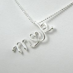 custom initial necklace - sterling silver love letter - monogrammed gift for bridesmaid, friend, sister, love couple. $34.00, via Etsy.