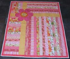 Strip quilt with appliqued flower.  How quick and SWEET is this???  Good use for that PINK JELLY ROLL>>>>