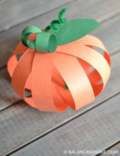 Super simple, quick and cheap paper strip pumpkin craft. Perfect for kids and the classroom. Use fancy scrapbook paper and it is perfect for grown ups too!