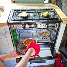 The camp chef propane oven works similar your household oven, albeit smaller. It is highly insulated to keep the temperature in and can cook for hours on end. We think it's best for people who have the space and are able to tow around a tank of propane. It would make a great addition to a large campervan kitchen setup.
