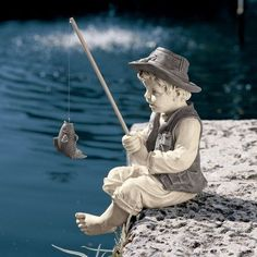 Design Toscano Frederic the Little Fisherman of Avignon Garden Statue by Design Toscano. $29.95. Great for outdoor ponds. Cast in high-quality resin. Dimensions: 9.5W x 6.5D x 15H inches. Charming child fishing with rod and fish. Realistic detailing and two-tone finish. NG32122 Features: -Statue.-Design Toscano exclusive. Construction: -Quality designer resin construction. Color/Finish: -Two tone stone finish.. Save 40% Off!