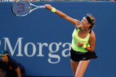 Victoria Azarenka (BLR)[1] hits a serve against Serena Williams (USA)[4] during the Women's Final of the 2012 US Open. - Philip Hall/USTA