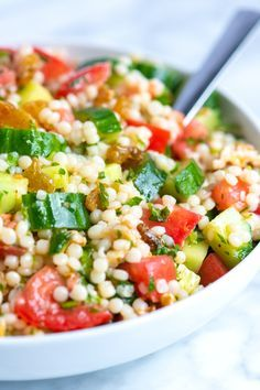 How to make light and healthy couscous salad with a simple lemon vinaigrette, cucumber and herbs. We love this light couscous salad — it doubles as a side, can be the main event or works well topped with grilled chicken or Adam's favorite, shrimp! Couscous Salad Recipes, Couscous Salat, Couscous Salad Dressing, Israeli Couscous Salad, Pearl Couscous Recipes, Mediterranean Couscous Salad, Simple Couscous Recipes, Cooking Couscous, Vegetarian Recipes