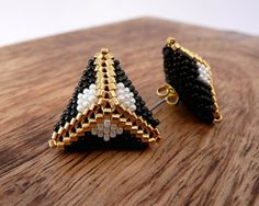 Items similar to Beaded Statement Earrings with Gold plated beads. Pyramid triangle earrings statement studs bridesmaid girl gift custom minimalist modern on Etsy Beaded Statement Earrings in Gold Black and White. Seed Bead Earrings, Beaded Earrings, Beaded Bracelets, Statement Earrings, Triangle Earrings, Beaded Jewelry Patterns, Beading Patterns, Diy, Crochet Hats