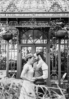 B&W portrait of bride and groom in front of the vintage woodland mosaic solarium at Denver Botanic Gardens on their wedding day in Colorado. - April O'Hare Photography http://www.apriloharephotography.com