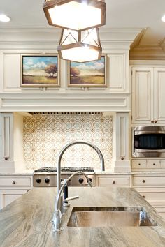 ~ Living a Beautiful Life ~ Love the use of the paintings over the stove