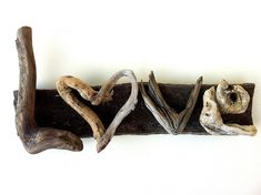 "Driftwood Art ""Love is the Best Four Letter Word"" 
