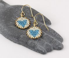 The perfect way to send a little love to someone special. Be sure to treat yourself, too!    The mandala is a symbol of community and connection. Ive designed a sparkling heart design into the intricate pattern of these earrings by adding tiny Japanese glass beads one at a time. These lightweight and delicate earrings are beadwoven with high quality, durable beading thread and will provide lasting enjoyment.    34mm length (including earwire) / 15mm mandala design. Gold-fill earwires. If...