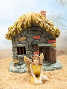 A cozy little cottage fairy house for your mini fairy gardens.