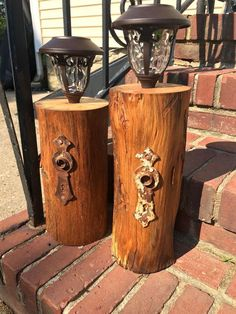 Solar lights attached to tree stumps and embellished with hardware...