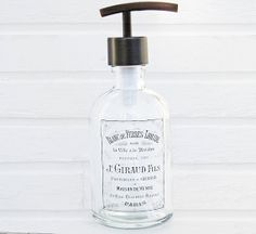 Glass Soap Dispenser.  Vintage Style Soap Dispenser with Antique French Label.   The label has a clear background for a nice clean look.   Comes with metal soap pump in your choice of the following finishes; Bronze, Stainless / Nickel, Copper or Chrome.
