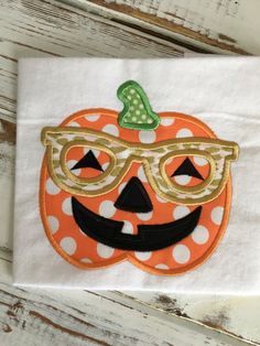 Pumpkin Glasses Jackolantern Halloween Applique Embroidery Design 4x4 5x7 6x10 8x12 by HugABugShop on Etsy https://www.etsy.com/listing/460663678/pumpkin-glasses-jackolantern-halloween