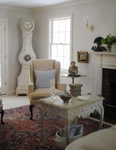 """""""The living room with Gustavian clock, Rococo tea table & American wingback chair.""""  Loi Thai"""
