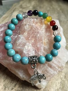 A personal favorite from my Etsy shop https://www.etsy.com/ca/listing/486084301/turquoise-quartz-nd-7-chakra-bead