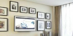 i the idea of a custom frame around the tv to match the other pictures frames on the wall.