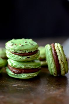 Mint chocolate chip macarons. http://www.yammiesnoshery.com/2015/04/mint-chocolate-chip-macarons.html
