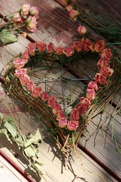 Rustic heart wreath with roses.
