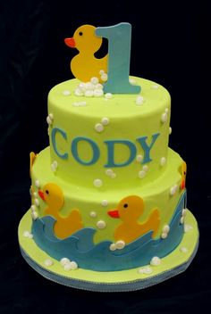 First birthday duck cake. Probably decorated with edible paper?