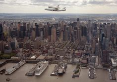 space shuttle enterprise flying over manhattan