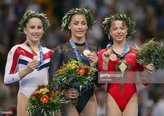 Carly Patterson of United States , Catalina Ponor of Romania and Alexandra Georgiana Eremia of Romania receive their medals for the women's artistic gymnastics balance beam event on August Get premium, high resolution news photos at Getty Images Olympic Sports, Olympic Athletes, Olympic Games, Elite Gymnastics, Gymnastics Posters, Artistic Gymnastics, 2004 Olympics, Summer Olympics, Artists