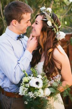 Wild bohemian flower crown and bouquet in whites and greens for rooftop styled shoot. Crown has olive, cotton,  privet berries, seeded eucalyptus. Floral design by Green Snapdragon; photo by Inkspot Photography.