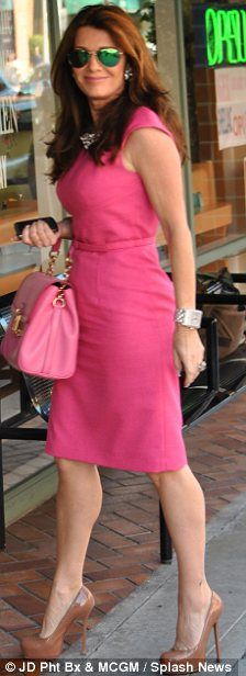 Lisa Vanderpump, green aviator sunglasses