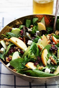 Crisp apples, dried cranberries, feta cheese, and hearty walnuts come together in a fresh Autumn salad.