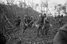 30 Apr 1968, A Shau Valley, South Vietnam --- 4/30/1968-A Shau Valley, South Vietnam- Wounded American soldiers are assisted by buddies during Operation Delaware in this valley in South Vietnam's Quang Tri Province. They are part of a joint allied force sweeping into the strategic valley, which has been controlled for two years by Communists. --- Image by © Bettmann/CORBIS