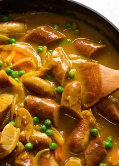 The ultimate retro sausage recipe – Curried Sausages! Browned sausages in a curry flavoured sausage gravy with carrots and peas, it's totall. Sausage Recipes, Pork Recipes, Cooking Recipes, Paleo Recipes, Cooking Tips, Sauce Au Curry, Recipetin Eats, Recipe Tin, Sausages