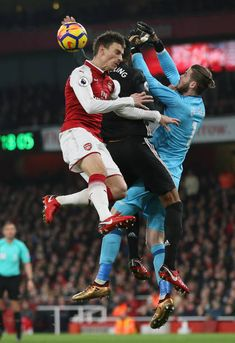 Laurent Koscielny of Arsenal and David De Gea of Manchester United during the Premier League match between Arsenal and Manchester United at Emirates...