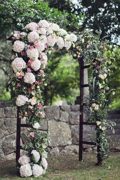 Elegant pink and white floral wedding ceremony chuppah; Featured Photographer: Sonya Khegay